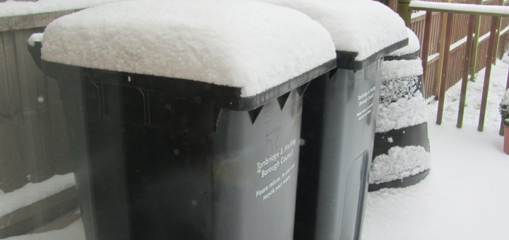 Compost bins in snow
